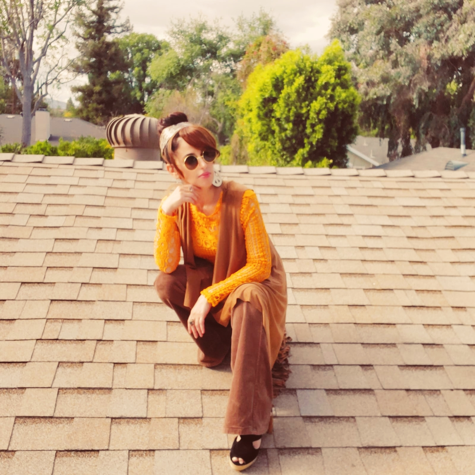 70's look, girl on a rooftop - yellow top - brown bell bottom pants